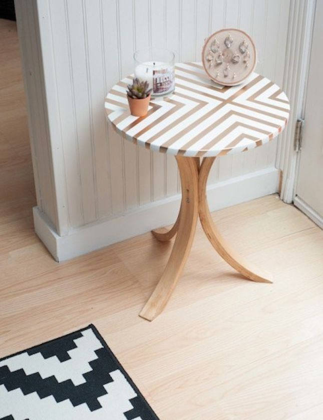 Use painter's tape and gold paint to make this patterned side table.