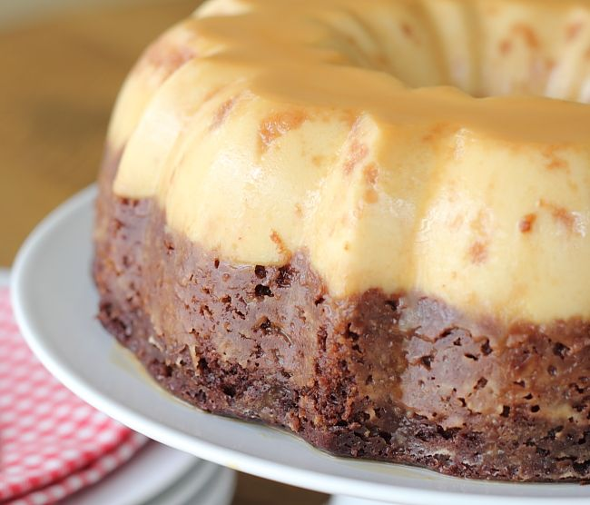 Easy Chocoflan - It's like a magic cake. Chocolate moist cake on the bottom, custard on the top, caramel on top - All baked at one time in the same bundt pan! And, it is out of this world delish!!!