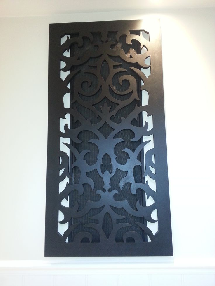 This is my return air filter in my hallway. I did not want an ugly return air filter ruining the look of my entrance hall, so i decided to conceal it with a decorative screen which i painted black. The filter is attached to the wall using 3M double sided velcro so it is easily removed and the screen is hanging on 2 hooks which just lifts off for easy cleaning.