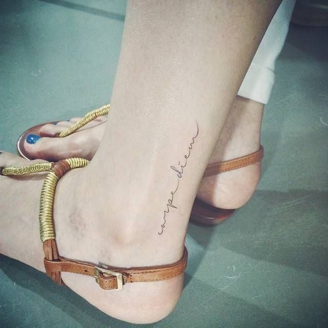 """Carpe diem"" tattoo on the left ankle. Tattoo Artist: Doy"