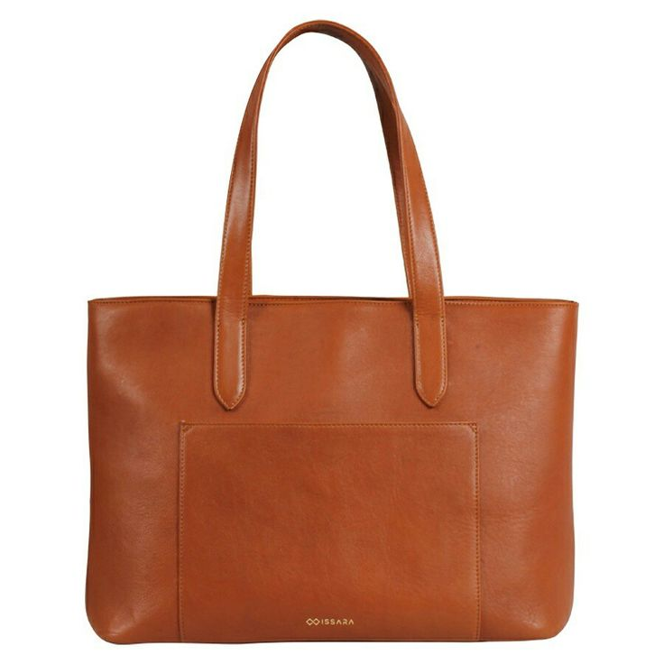 """One of our best sellers. Handcrafted from premium full grain leather to survive a lifetime of carrying your daily essentials. Fits a 13"""" laptop and has a full length zipper to protect your valuables from prying hands.   Shop: www.issara.co/shop/ziptop-tote  #tote #leatherbag #travelessentials"""