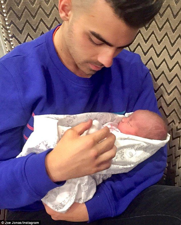 Uncle Joe: Jonas shared an aw-inducing photo of himself and new niece Valentina to Instagram on Wednesday