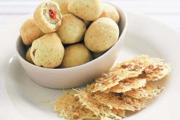 Easy to make Crispy Crunchy Baked Green Olives Recipe make an interesting finger food platter when catering for the crowds for something completely different!