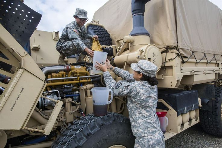 New Jersey Army National Guard Spcs. Michelle Rivera, left, and Jennifer Llufire prepare their vehicle at Cape May Courthouse, N.J., for a deployment to support the Florida National Guard in anticipation of Hurricane Irma, Sept. 7, 2017. Air Force photo by Master Sgt. Mark C. Oslen