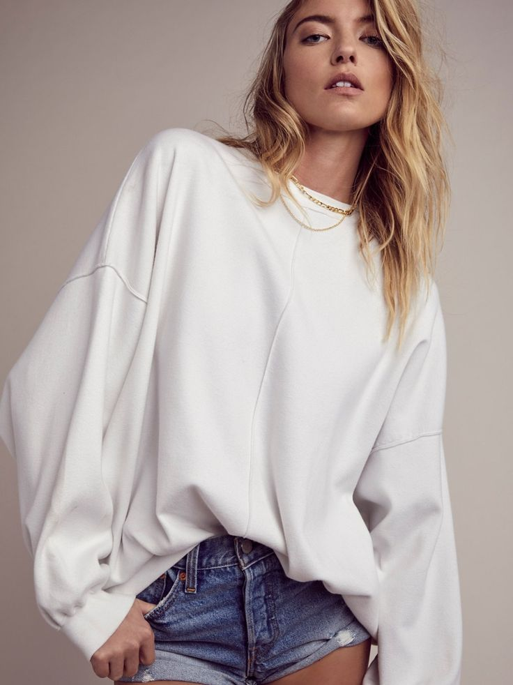 City Girl Sweater | Effortlessly oversized sweater in a soft yet thick and stretchy fabric. Dramatic dolman sleeves and a high low hem.
