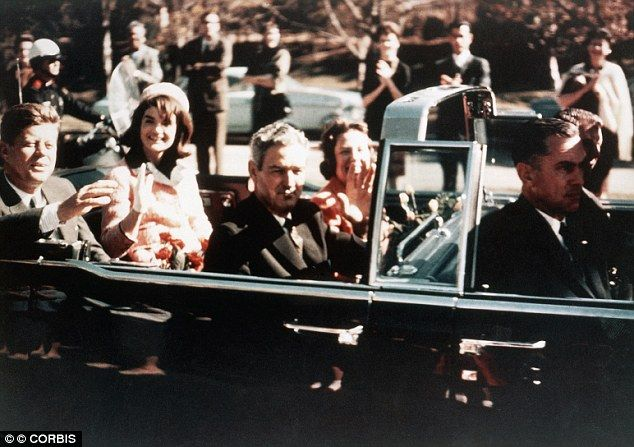 Dallas, Texas - Prior to the assassination, President John F. Kennedy, First Lady Jacqueline Kennedy, and Texas Governor John Connally ride through the streets of Dallas, Texas on November 22, 1963