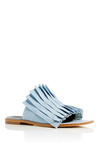 Easy, effortless, and chic, these **Tibi** sandals feature a pleated cotton upper in summery sky blue.