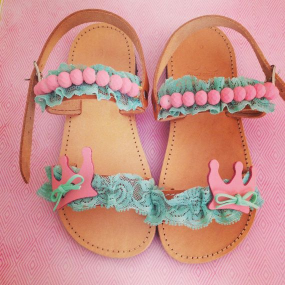 Handmade leather baby sandals in pink and turquoise colors