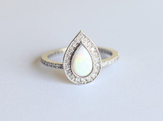 Stunning and genuine handmade full eternity pear-shaped opal ring with a Diamond halo. Product details Middle gemstone Gemstone: Opal Size: 7x5 mm