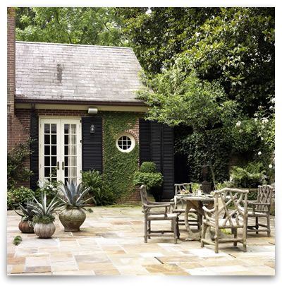 ivy growing - love the round window, french doors and green courtyard