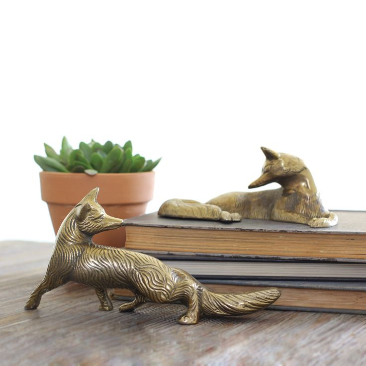 The Secret Of The Fox Brass Figurine Setis comprised of two intricately cast aluminum brass foxes turning towards each other. This set is perfect on side tables, nightstands and on bookshelves as a no...  Find the Secret Of The Fox Brass Figurine Set, as seen in the The Grand Storyteller of Design Collection at http://dotandbo.com/collections/the-grand-storyteller-of-design?utm_source=pinterest&utm_medium=organic&db_sku=95578