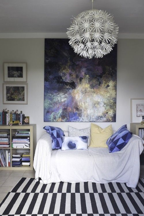 "Sneak Peek: A Jewelry Maker's Provençal Home. ""In the living room, the large oil painting is by U.S. artist Kimberly Bates. To left, two smaller female nudes by  artist Ben Readman, red papercut print just out of shot to right is an early Rob Ryan. Rug and Various cushions Ikea, Sofa Parker Knoll. On unit to left of photograph is book collection of Coralie Bickford Smith Penguin classics."" #sneakpeek"