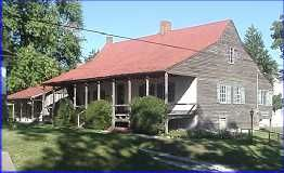 French Creole House ~ The Jean Baptiste Ste. Gemme Beauvais House /Amoureux House was built over-looking Le Grand Champ agricultural fields in 1792. This is a French Creole vernacular post in ground (poteaux-enterre) construction one of three in Ste. Genevieve and only five in the US. Its cedar log walls are set directly into the earth, without a foundation. The roof system consists of king-post trusses and longitudinal wind braces. Ste. Genevieve, Missouri.