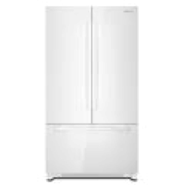 Jenn Air white floating glass refrigerator. I am in love with it. Over stainless.
