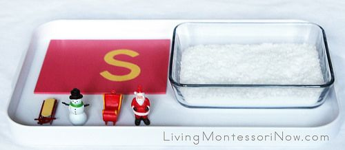Letter Sound /s/ Tray with Instant Snow Sensory Bin - a fun Christmas and winter activity using instant snow, Montessori sandpaper letters, and language objects to reinforce beginning phonics skills; post includes YouTube video with tutorial