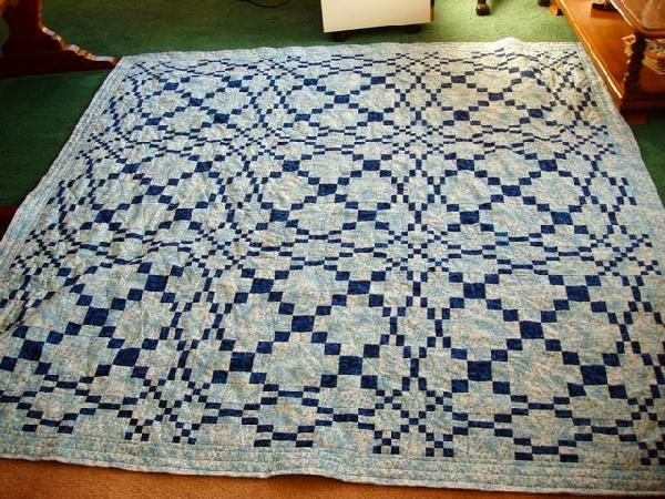 Rolling waves quilt.  It's laying flat on the floor but gives an optical illusion