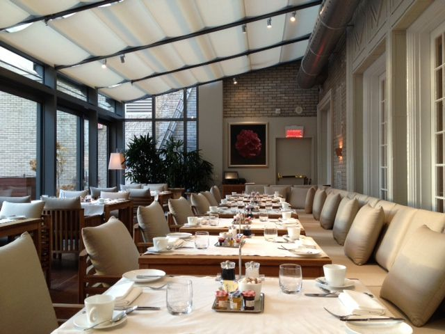 The Greenhouse inside Maison Boulud, sunny by day, romantic at night.