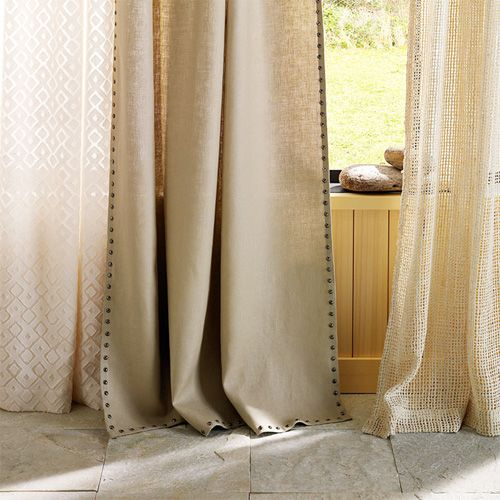 Nailhead  Trimmed Curtains-a neat idea. Would probably add weight to unlined panels to help them hang better too