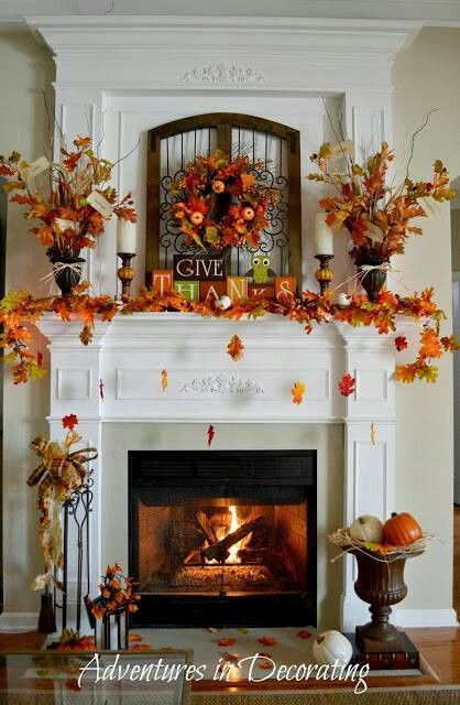 a fireplace all decorated for thanksgiving