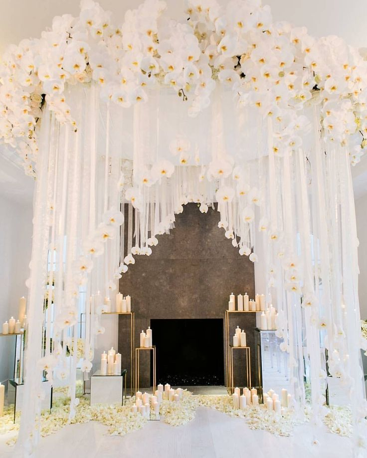 Major crush on this jaw-dropping setup by @whitelilacinc! Swooning over the abundant use of white orchids on this bridal canopy especially the hanging ones that transcends such an elegant and romantic mood. Incorporating lots of whites and candles this white affair setup truly the epitome of a delicate wedding ceremony setup! Serene enchanting and magical at the same time! Who dreams of this setup too? Double tap if you do! Decoration @yseidod @nikkibrown_ @whitelilacinc / Photography…