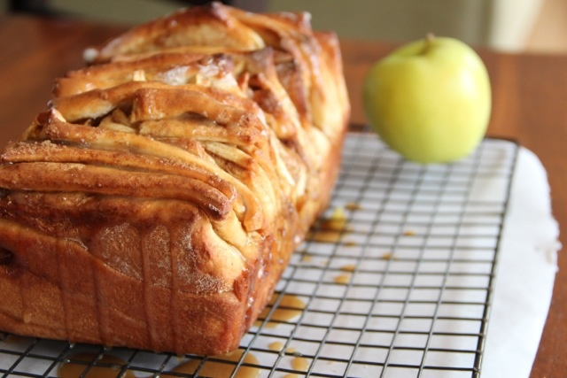 Carmel Apple Pull Apart Bread  2-3/4c all-purpose flour (plus 1/4 cup or more, if needed)  1/4c sugar  2-1/4t active dry yeast  1/2t salt  4T butter, melted  1/3c milk  1/4c warm water  1t vanilla extract  2 eggs  For the filling:  3/4c brown sugar  2t cinnamon  pinch of salt  3T butter, melted  1 large tart apple, peeled, cored, and diced (Golden Delicious or Granny Smith recommended)  For the Caramel Glaze:  2T butter  1/2c brown sugar  2T milk
