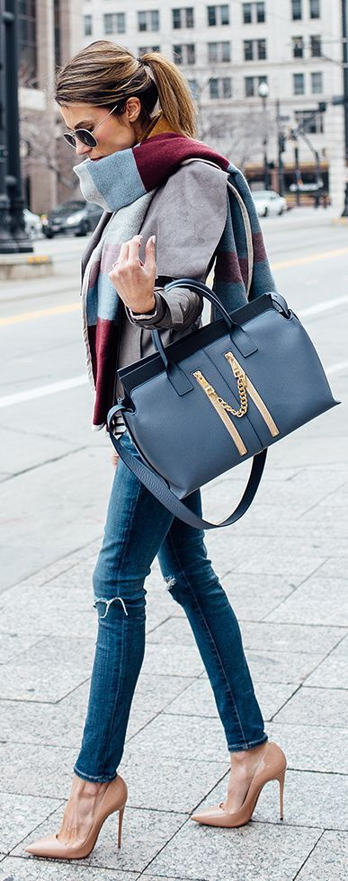 Fall look - blue jeans, heels, scarf and classical bag. Top 20 trends for this fall 2015.