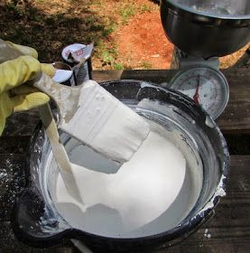 Amish Whitewash  1 gallon water 2 pounds salt 7 pounds hydrated lime.  Mixing whitewash to paint the inside of the chicken coop.