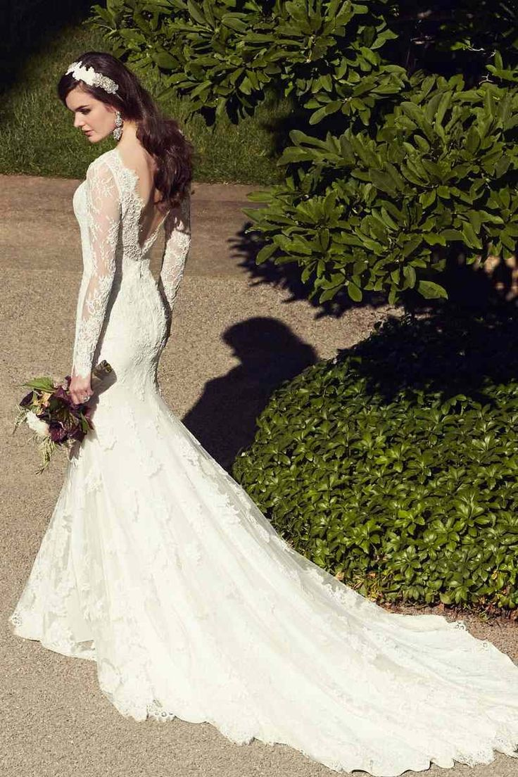 This French-inspired A-line wedding dress features soft lace over crepe in your choice of ivory and white. The skirt flows free into a traditional train. @essensedesigns