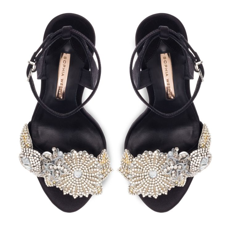 Our Lilico sandal has been updated in sleek black satin with embellished crystal flower front strap.