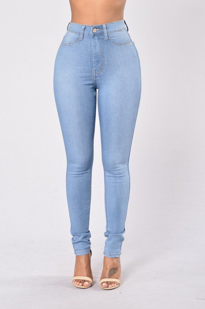 - Available in Light Blue - High Waist Jeans - Faux Front Pockets - Skinny Leg - Back Pockets - 54% Cotton, 44% Sirorayon, 2% Spandex