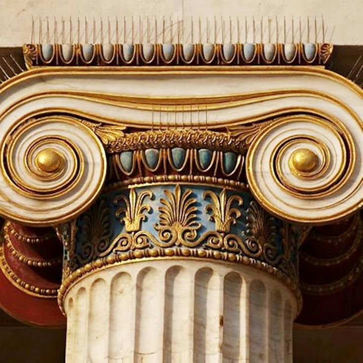 A closer view of the capital of an Ionic pillar, though it has been modernised and repainted.