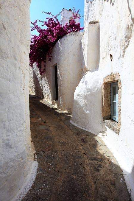 Patmos - Greece: white rounded architectural shapes that appease the violent bougainvillea colors- the shapes and the forms of Greek summers