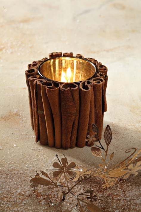 Decorate a candle holder with cinnamon quills for Christmas, driftwood for nautical party or small stones for garden party