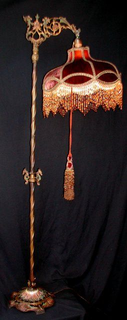 This is a very warm colored shade and vintage looking. The shade design is an excellent choice for the lamp. The lampshade fabric is a silk velvet with  tones of copper and deep gold. Trimmed with  rust colored metallic braiding. Beaded fringe complements the fabric. Matching bronze-copper tassel comes with the lamp. Lots of light travels downward and a soft light filters through the fabric.