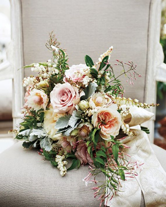 Blake Lively and Ryan Reynolds wedding - Martha Stewart Wedding style director Kate Berry created a lush bouquet of pink jasmine, andromeda, dusty miller, and blushing bride hydrangea for Lively. She dipped select petals in subtle rose-gold glitter to play up the embroidery of the same color on her Marchesa wedding dress.