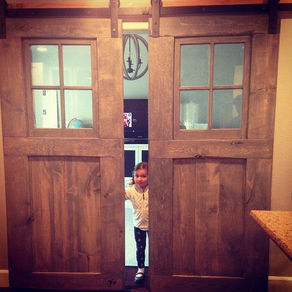 All custom made sliding barn doors with windows for a vintage or modern look for your home. These are interior doors that are trendy and give your home a personalized vintage look. We can customize the color or stain and also the pattern to your liking. The windows add a neat look to the doors and also let light in. Made to order whatever size you might want and is done in 4-6 weeks. Well usually sooner then that but just to be safe. (Pictures are ALL doors we have made!) We were featured on…