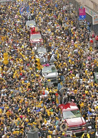 Handing out THANKS CHAMPS cheer cards at the Pittsburgh Steelers Super Bowl parade, Jan. 2006