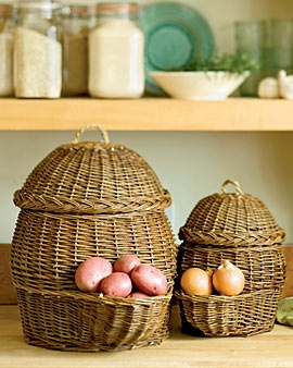 """""""Keep Your Potatoes and Onions in Old World Vegetable Baskets"""" I want these!!!  """"Plastic grocery bags retain moisture, speeding the demise of potatoes and onions. These breathable woven baskets, used for centuries in Europe, are a better solution. They fill from the top, and dispense vegetables from the pocket below. And they add a little country style to your kitchen or pantry. Set of two; large holds about 30 lbs. of potatoes, small holds about 6 lbs. of onions. Hand-woven willow with…"""