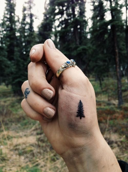 Pine tree tattoo --- I wouldn't want it there, but I like the idea of it