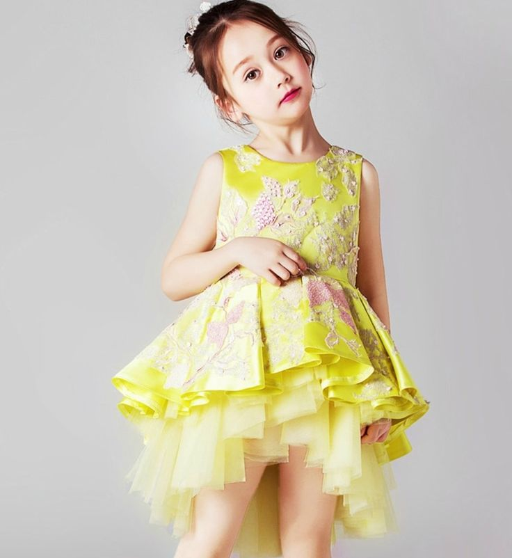 Light Yellow High Low Gown--Made To Order - High Quality. Beautiful & Elegant Paillette Beads & Floral Applique Round Neckline Sleeveless Tiered Layered Little Girl High Low Dress. Available from 2 until 12 years old. Material: Cotton, soft polyester fiber, tulle mesh. Color: Light Yellow. Please do compare your  little girl measurements with our size chart below before deciding her size.