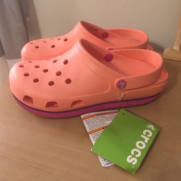 Women's Crocs Retro Clog NWT Crocs Retro Clog. Women's size 9. Men's size 7. Color is melon/vibrant violet. Relaxed fit. crocs Shoes Mules & Clogs