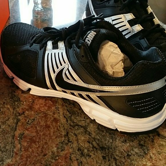 Nike wide width shoes black, silver, white Brand new never used or worn. Men's size 10.5 which fits women's size 12 Nike Shoes Athletic Shoes