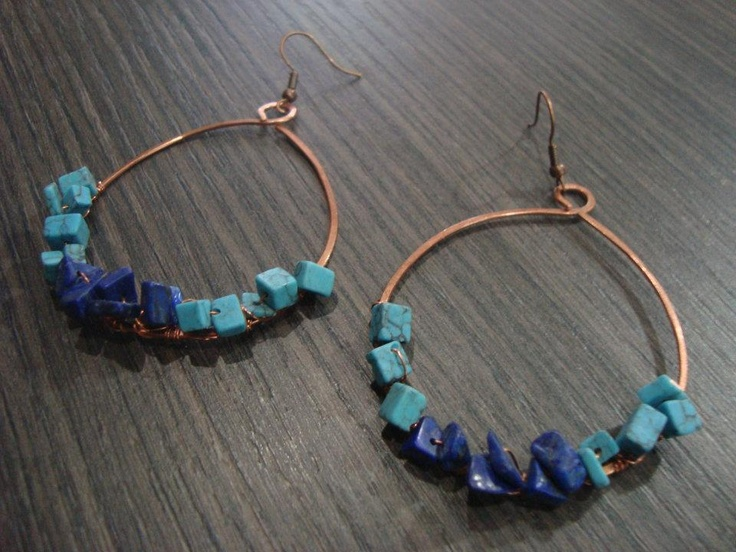 Wire earrings with dark and light blue beads.