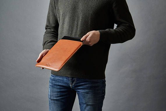 Fits all iPad Air models. Simplicity at its core, our slim leather cover collection is an authentic classic of personal protection and traditional craftsmanship. Tailored to snug your iPad Air tight and protect against bumps and scratches thanks to its fully padded wool felt interior. Carry your tablet in a relaxed and personal fashion. Sporty, smart, casual, our iPad Air leather sleeve cover will suit your attire may it be jeans or a suit and always look superior. Our iPad Air Leather…