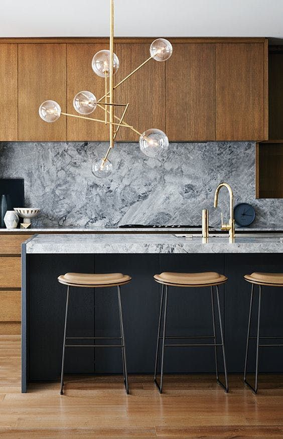 Lighting isn't usually the first thing you notice about a kitchen—if you notice it at all. But these 13 kitchens are the exception to that rule. Here, dramatic pendants, sconces and chandeliers serve as a reminder that a kitchen can be both functional and beautiful.