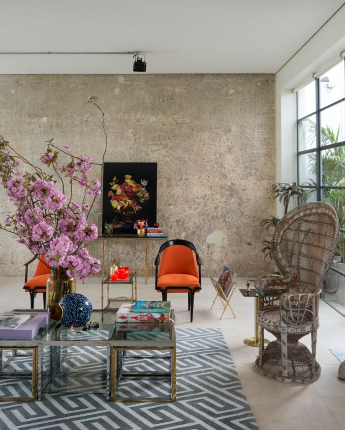 Hollywood glamour meets raw industrial in this converted factory home high shine details and modern shapes combined with the pinkish tinge of the concrete