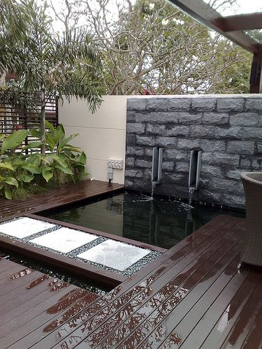Outdoor Koi pond! Simple clean design.
