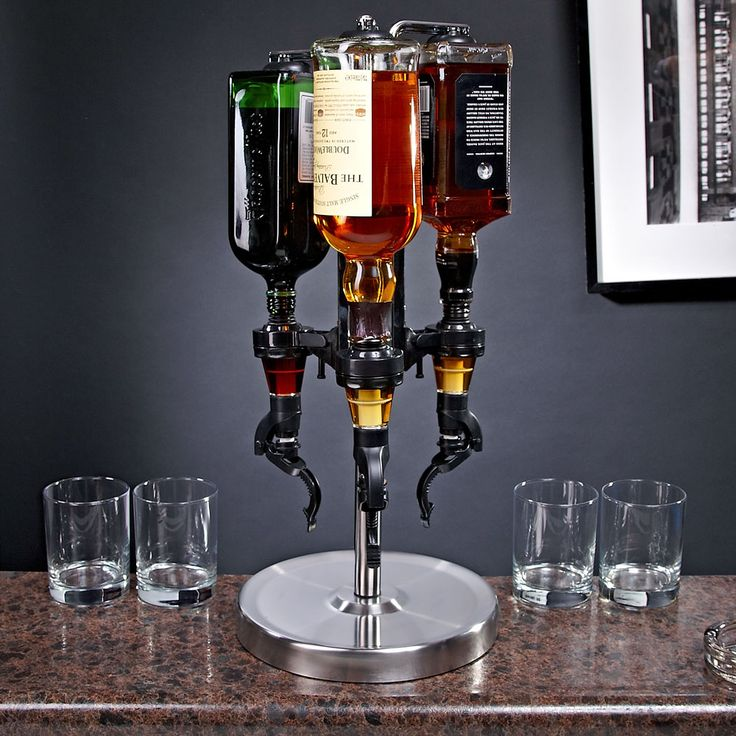 Effortlessly allow your guests to professionally make a variety of cocktails with this cool, revolving liquor dispenser. Each spigot has an easy fountain style, push-and-dispense feature  the two red...