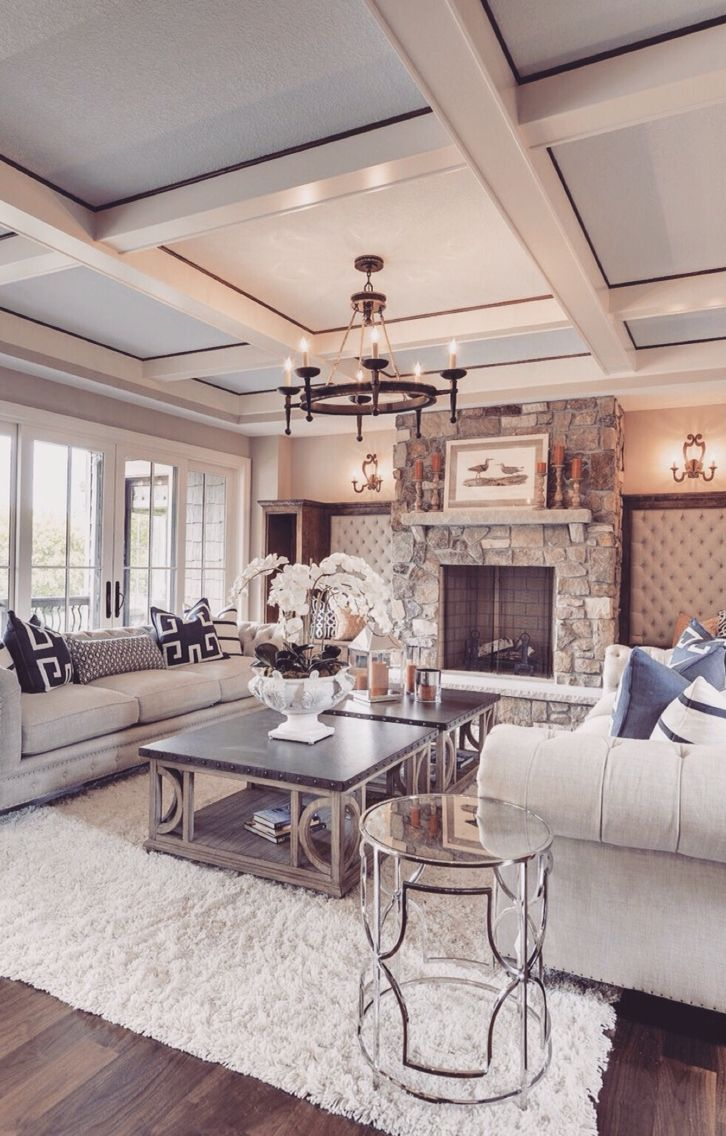 """What  gorgeous room! Lots of Windows! Coffered Ceiling! That Fireplace!     (*I'm confused as to why the walls are tufted/upholstered in either side of the fireplace. In all the years I've been a designer, I've not seen this treatment application in this location. It's a bit too """"boudoir"""" for the family room. There are a few other """"outside of the box"""" things that would look better/be more appropriate. Personal Opinion. GL