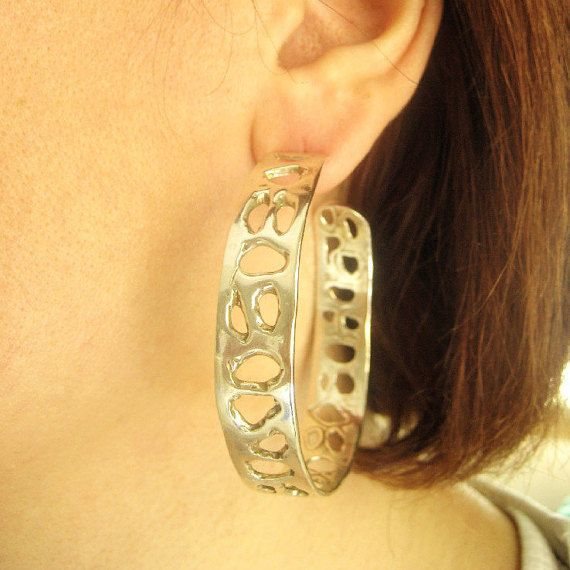 Handmade sterling silver earrings .Silver hoops with holes for a unique style .You could match them with the bracelet or ring.Please check my list.